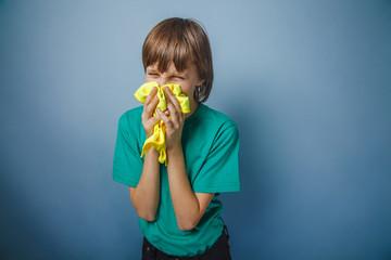 European-looking boy of ten years is ill, a handkerchief,