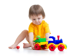 little boy toddler playing with toy