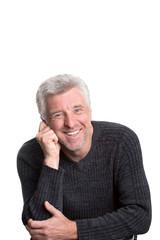 mature older man sitting  smiling