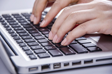Nice hand of a woman typing computer