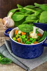 mix vegetables in a blue ceramic pot