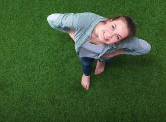 Young happy woman in green grass