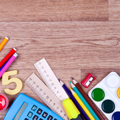 School supplies on a wooden background