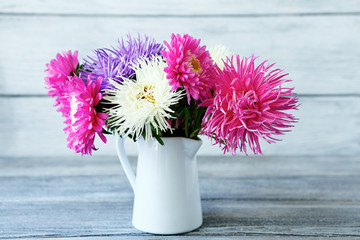 Colorful asters in a vase