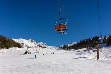 ski slope and chair lift in Pila, Aosta, Italy