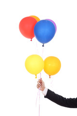 business hand with colorful balloons
