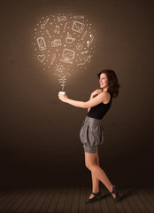 Businesswoman holding a white cup with social media icons