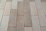 Fototapety Ceramic floor tile, background. Imitation of a parquet board