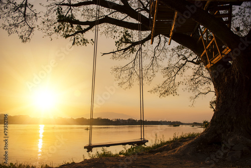 Papiers peints Plage lone swing at river side and sunset ,Thailand