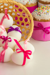 Easter cake and decorated eggs on a white background