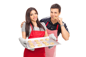 Man tasting the cookies baked by his girlfriend