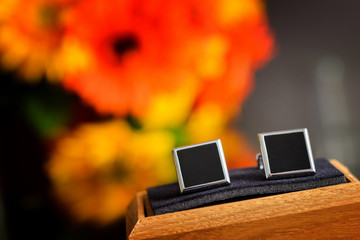 Special cufflinks sitting on a wooden surface