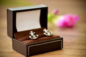 Shirt cufflinks shaped boat anchor placed in support