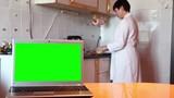Laptop.  Green screen. Woman prepares dinner.