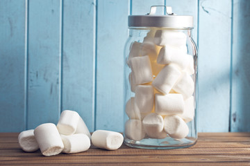 white marshmallows on wooden table