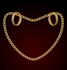Jewelry two rings on golden chain of heart shape