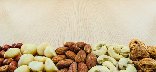 Mixed nuts on wood background