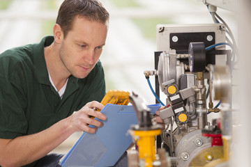 Male technician repairing agriculture machinery