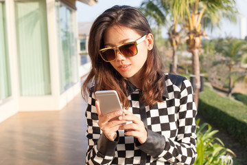 portrait of happiness face young woman reading message on mobile