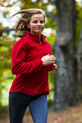 Healthy lifestyle - woman running in park