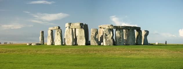 Man who admires stonehenge