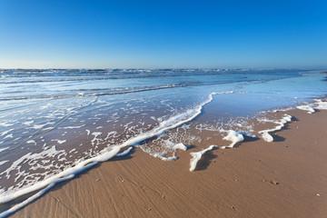 North sea sand beach and blue sky