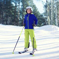Professional skier boy in sportswear and helmet