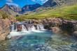 Small waterfall on the Isle of Skye in Scotland - 79389364