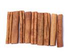 Top view row of aromatic cinnamon sticks. poster