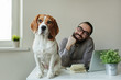 Smilling man in glasses with beagle on table - 79391360