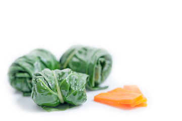 Chard rolls with carrot isolated on white
