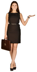 Business woman holding in his hand leather briefcase.