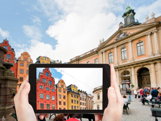 tourist taking photo Stortorget square Stockholm