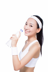 healthy asian woman with towel and water bottle