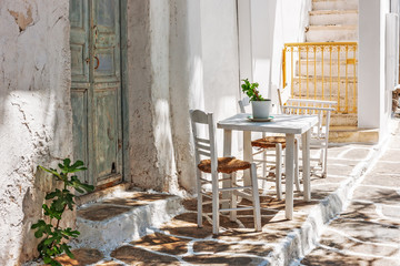 Table and chairs outside a typical house in Mykonos