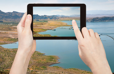tourist taking photo of Lake Mead in Nevada