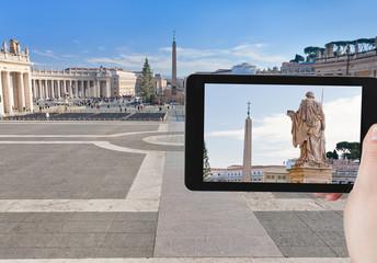 tourist taking photo of obelisk on St.Peter Square