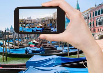 taking photo of gondolas near Piazza San Marco
