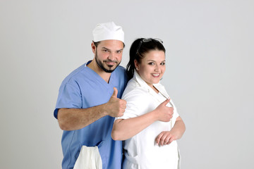 Clinical Team of Woman Doctor and Surgeon is Showing Nr.1 Sign