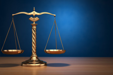 Concept of justice. Law scales on blue background.