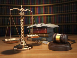 Justice concept. Gavel,  golden scales and books in the library