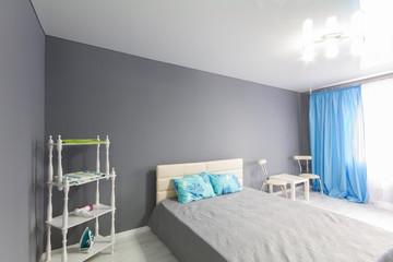 Interior of bedroom. Gray tone.