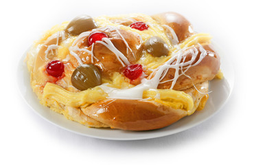 A danish pastry with custard, icing and cherries