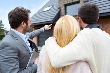 Real estate agent shows details to customers