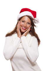 Young woman in a Santa hat holding out her hands