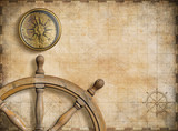 steering wheel and compass with vintage nautical map - 79403117