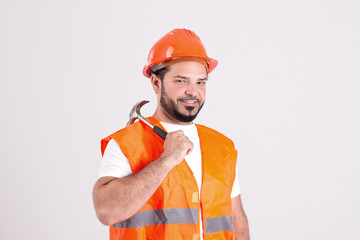 Good Looking Construction Worker with Bricklayer Hammer