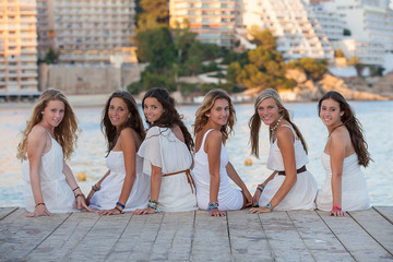 group of girls dressed in white for beach party