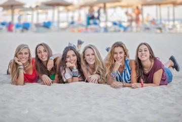 group on holiday on Calvia beach, Majorca Spain