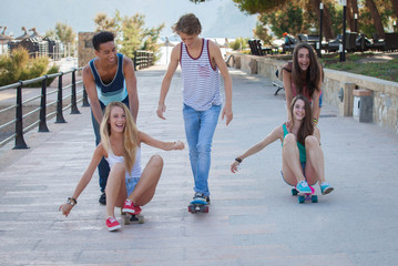 group of kids on skateboards having summer fun